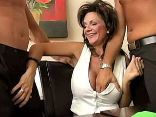 Busty brunette getting screwed hard by two fellows at work