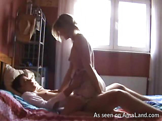 Longhaired absolutely naked girl is playing with her holes