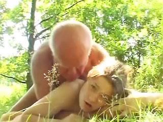 Cute dark brown teen giving old fart a hot blowjob outdoors